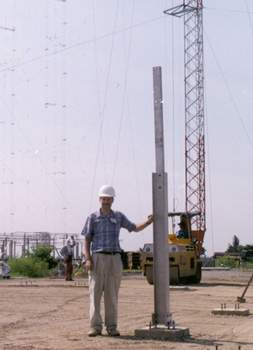 "FEBCanada missionary Mark Fuller standing in front of the ""Indonesia Antenna"", one of four high-gain antennas of Project SAVE. (September 1999)"